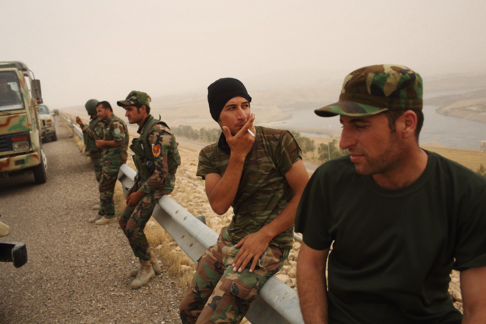 Kurdish forces positioned on Mosul dam after wresting it from IS.