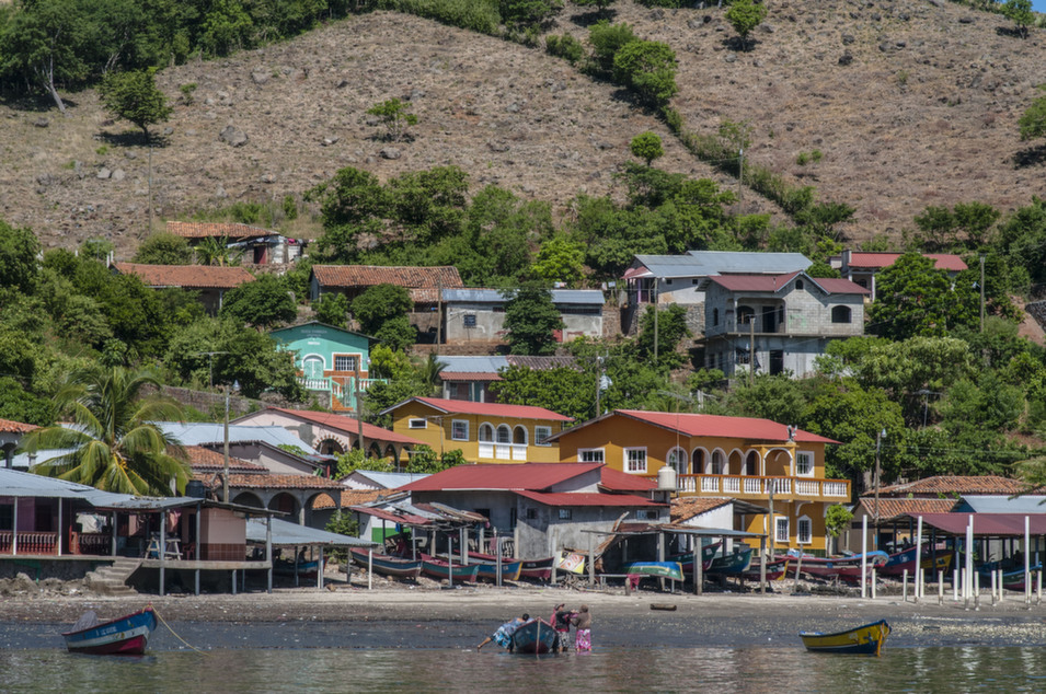 "The town of Amapala, spread across several islands in  southern Honduras, is not a rich place. Many of its residents live in  mud-walled shacks, with dirt floors. On the town's smaller islands, people lack regular access to fresh water and electricity. ""We live poor,"" fisherman Rodolfo  Núñez Pacheco, who lives on the island of Inglesera, told writer Maya  Kroth, who paid a visit to Amapala and the surrounding area for her piece in the latest issue of Foreign Policy.  ""But we live happy.""       Kroth's article looks at Honduras's preparations for a  radical experiment: the founding of quasi-sovereign municipalities known as ""zones  for economic development and employment"" (ZEDEs), or ""charter cities."" Built with  backing from foreign investors and granted wide-ranging legal and administrative autonomy, these cities, according to supporters, could bring new life to places like Amapala,  which is being eyed as a potential site for the first zone. But many Amapala residents are worried that a charter city,  once established, would just serve the interests of its corporate sponsors. ""We're only fishermen and farmers,"" one resident said at a town-hall meeting in July. ""We won't stand for the invasion of these model cities created for the benefit of the rich!""        Above, a view of San Carlos Island, also known as Garrobo Island, which could be affected by a ZEDE."