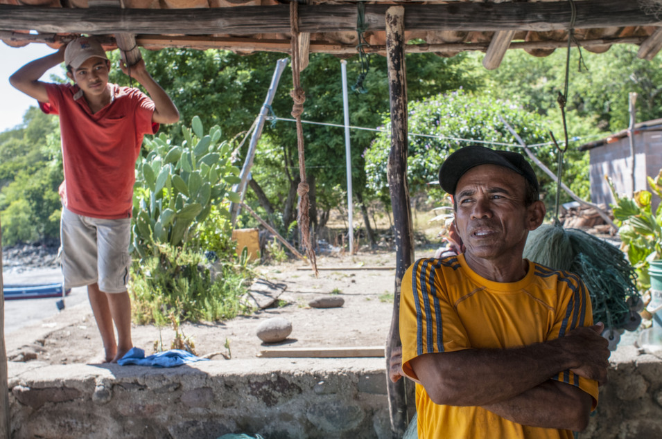 Fisherman Rodolfo Núñez Pacheco (right) says people have attempted to evict his family from Inglesera before.