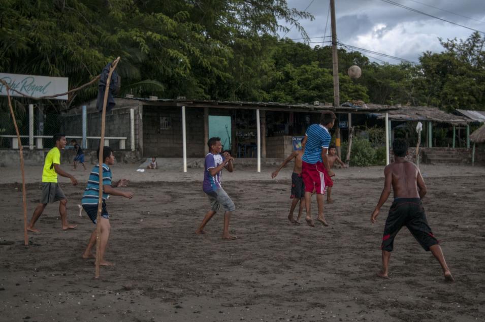 Boys play soccer on El Burro beach, Amapala.