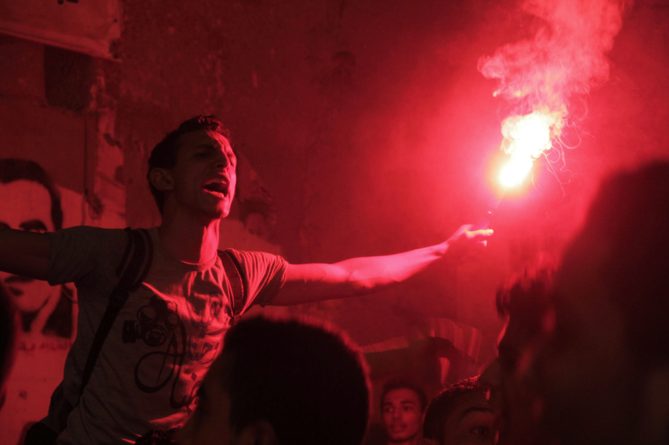 Members of the Egyptian youth group Ultras Nahdawi shout slogans during a protest in Giza, Egypt, on Sept. 2.       Stringer/Anadolu Agency/Getty Images