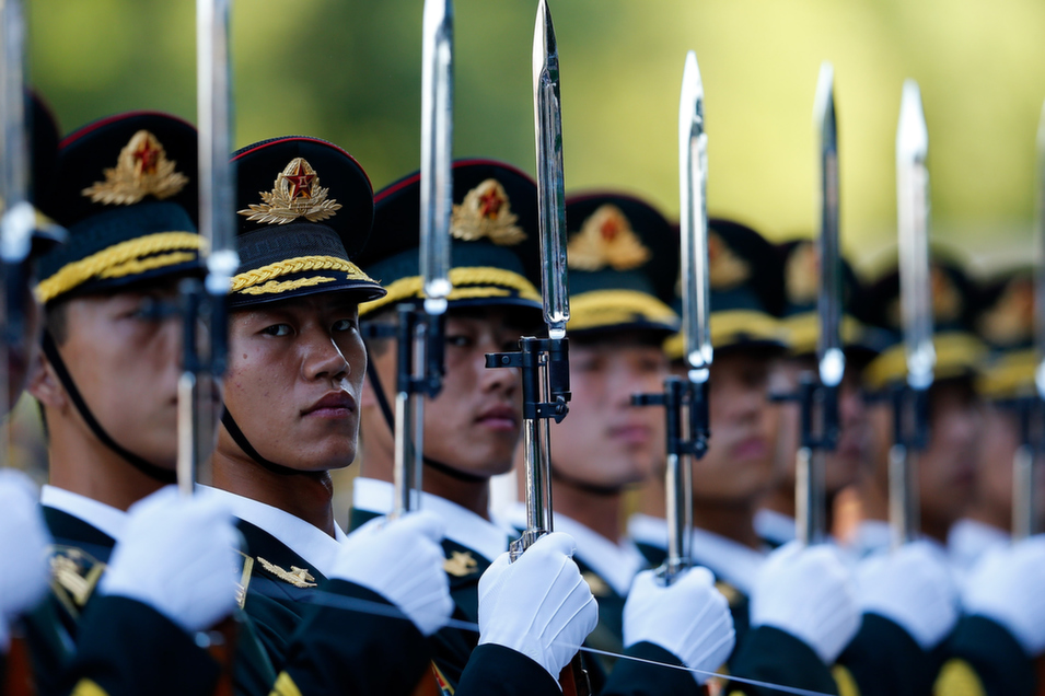 Members of a Chinese People's Liberation Army (PLA) honor guard measure their positions with string before a welcoming ceremony for Malaysia's head of state, Abdul Halim of Kedah, outside Beijing's Great Hall of the People, on Sept. 4.       Lintao Zhang/Getty Images