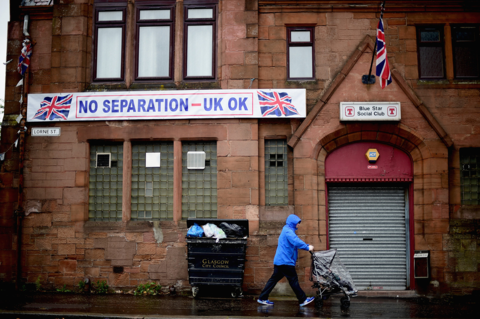 A man walks past the Blue Star social club in Glasgow, Scotland, Sept. 5. Scots will determine whether Scotland will be an independent country in a Sept. 18 referendum.      Jeff J. Mitchell/Getty Images