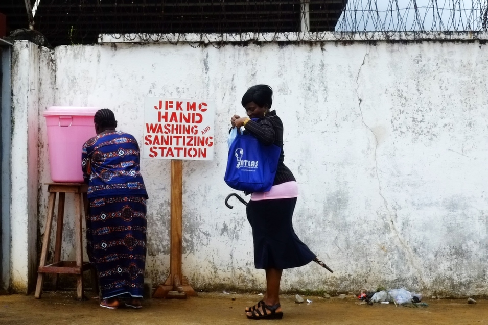 Women clean their hands with a sanitizer before entering Monrovia's John F. Kennedy Hospital, Sept. 1. Kim Yi Dionne looked at Ebola containment strategies -- and the hype surrounding some of them -- in a recent column for Foreign Policy.      Dominique Faget/AFP/Getty Images