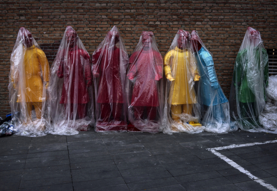 Colorful statues replicating China's famous Terracotta Warriors are covered in plastic before their installation an exhibition in Beijing, Sept. 3.      Kevin Frayer/Getty Images