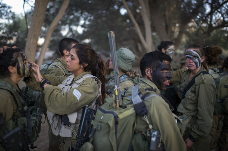"""Soldiers from Israel's Karakal battalion prepare for a graduation march near the Israeli-Egyptian border on Sept. 3. The combat battalion was formed in 2004 and is based in the Negev desert, on Israel's border with Egypt and Jordan. FP contributor Gregg Carlstrom reported from Tel Aviv on an ongoing political battle within the Netanyahu government in a Sept. 3 dispatch, """"Bibi's Next War."""""""