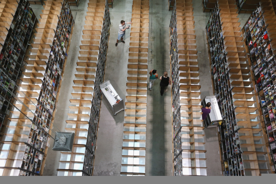 Workers place inventory at an Amazon warehouse in Brieselang, Germany, on Sept. 4.       Sean Gallup/Getty Images
