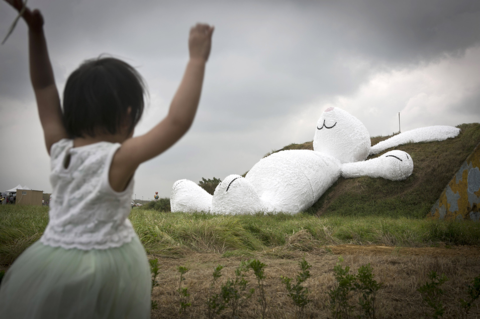 A girl plays in front of a sculpture by Dutch artist Florentijn Hofman at Taoyuan Naval Base, Taipei, Taiwan, on Sept. 4.       Ashley Pon/Getty Images