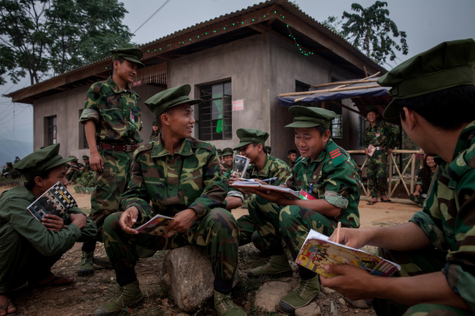 Young military recruits with very little training -- like the ones pictured above -- are expected to compete   with the well-equipped and experienced Myanmar's    army. KIA soldiers still   use the strategies of warfare that they learned from the British,   alongside whom they fought against the Japanese during World War II.      Diana Markosian