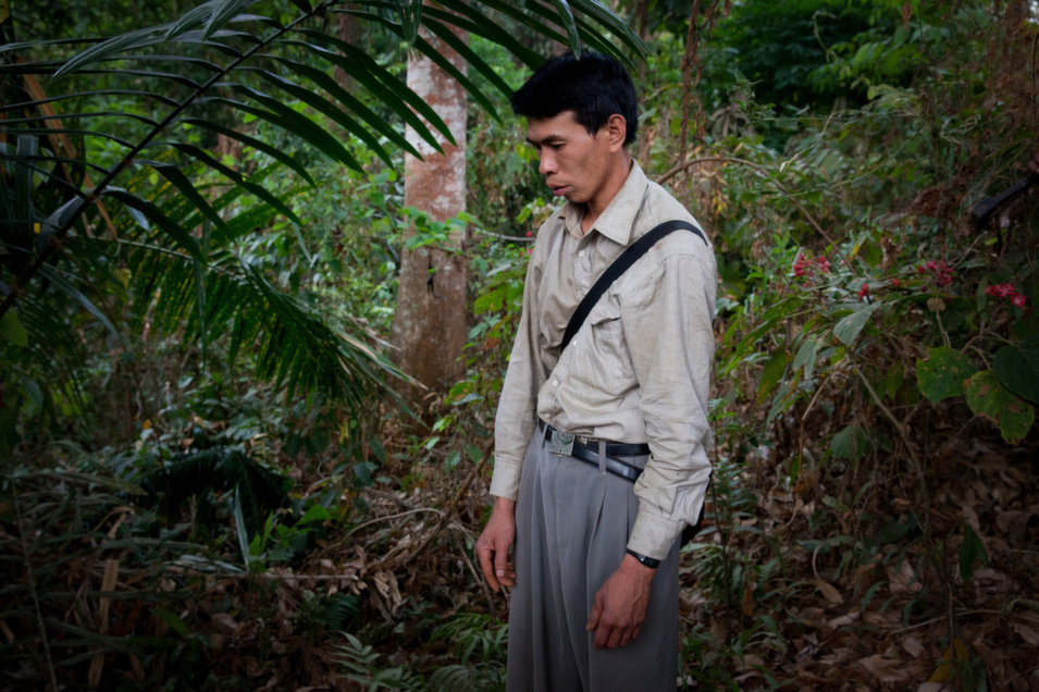 N'Brang Mun Naw, 32, discovers the body of his younger brother on the front lines. Mun Naw's brother was killed and buried by Myanmar's    soldiers on Apr. 16, following clashes between the two armies.      Diana Markosian