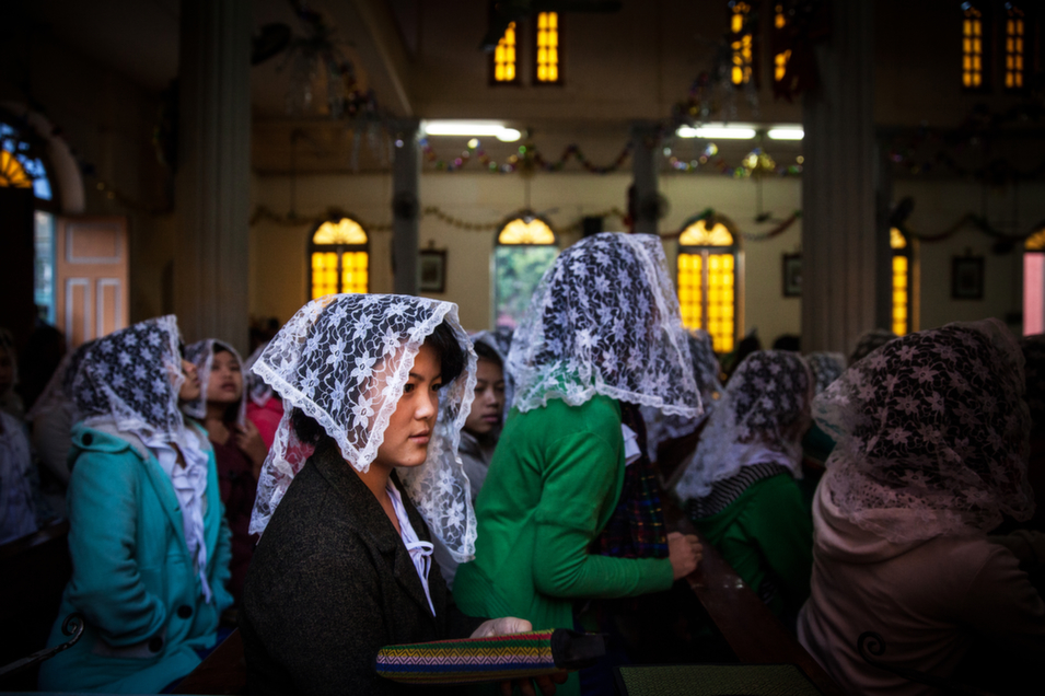 Worshippers attend morning mass at St. Francis Church in the Kachin capital of Myitkyina.      Diana Markosian