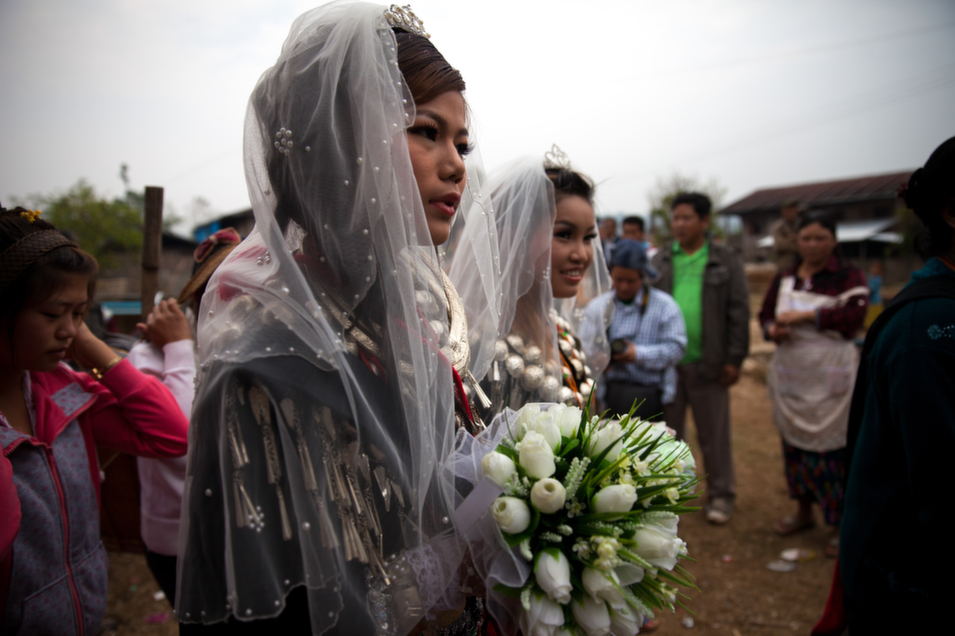Bride Nhkum Yawng Back Awng, 23, on her wedding day. Her family could not   afford to attend the wedding, so her best friend accompanied her. The   siege of Kachin state has turned life upside down for many Kachins as   some either opt out of marriage or postpone wedding ceremonies due to costs.      Diana Markosian