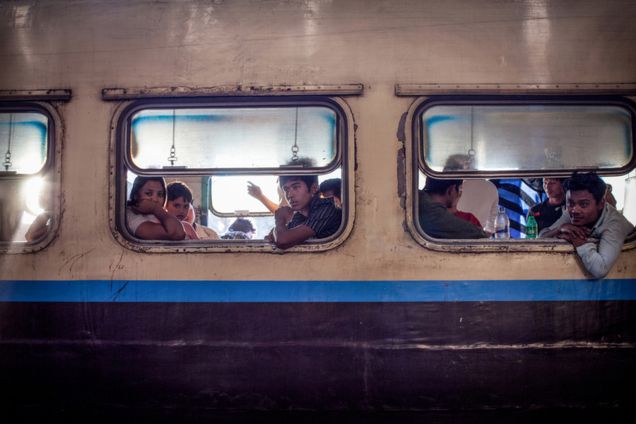 Kachin passengers on board a train in Kawlin, a town in the Sagaing   region. Many parts of Kachin state, just to the east, seem a world apart  from the rest of Myanmar. The area's frosty peaks and muggy valleys   make it a difficult region to navigate for Myanmar's    army.      Diana Markosian