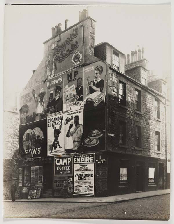 Advertisements on a tenement building near Edinburgh's St. Leonard's Street, southeast of St. Giles', in 1929. The neighborhood underwent large-scale renovations and clearances in the following decades; this building was slated for destruction.      National Library of Scotland