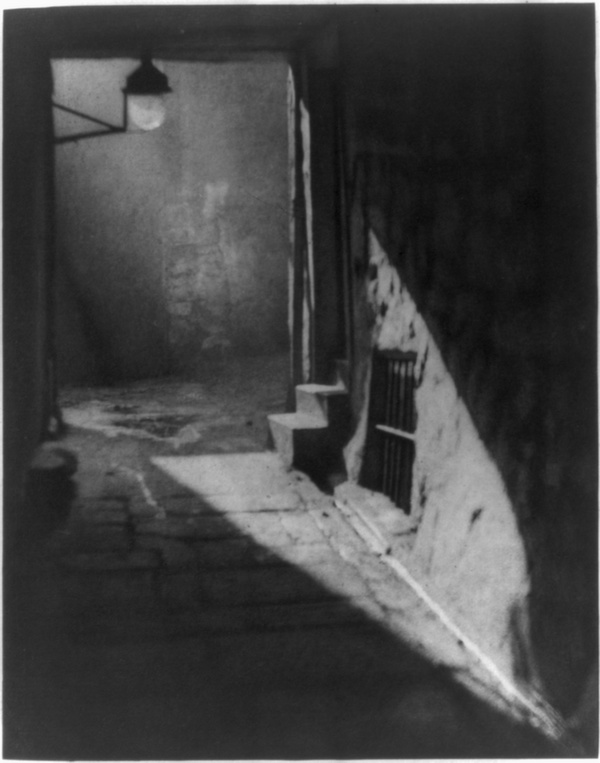 """A lantern and entryway in Weir's Close,1906, in a photograph by the   Boston-born Alvin Langdon Coburn. Stevenson's description of Edinburgh   deeply influenced Coburn's extensive photographs of the city; in his   1966 autobiography, Coburn wrote, """"""""For over fifty years I have followed  lovingly in [Stevenson's] footsteps, endeavouring to see [Edinburgh] as  I thought he saw it."""" Some of those footsteps are now untraceable:   Weir's Close disappeared in renovations later in the century and no   longer exists.      Library of Congress"""