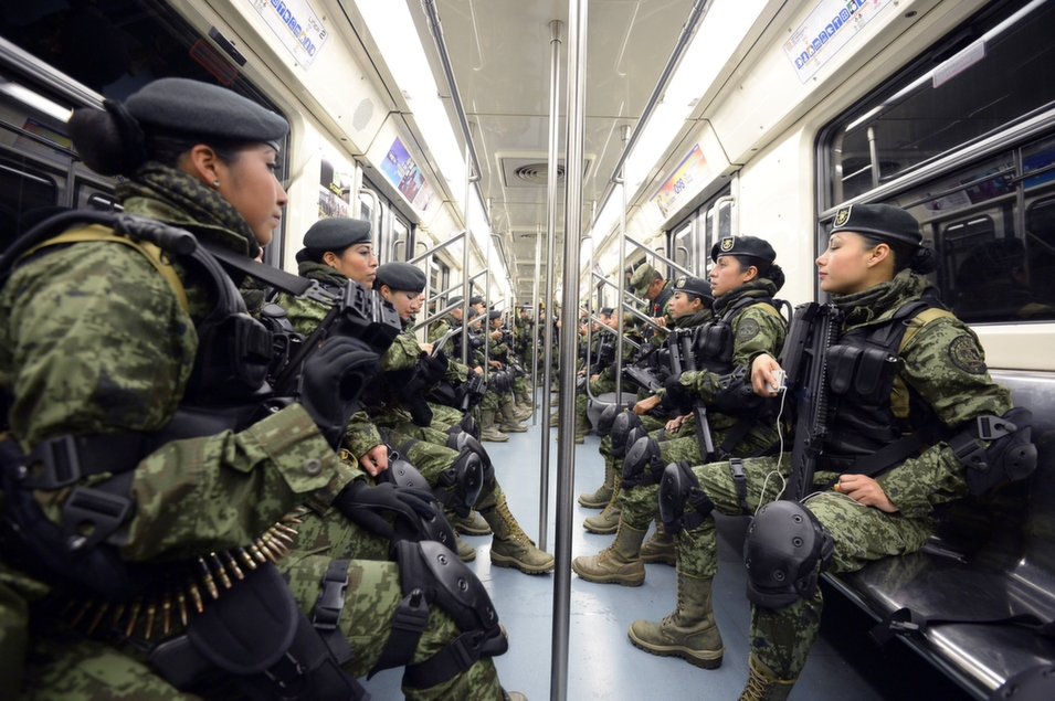 Members of the Special Forces of the Mexican Army take the subway toward celebrations for the 214th anniversary of Mexico's independence in Mexico City, on Sept. 16.      Alfredo Estrella/AFP/Getty Images