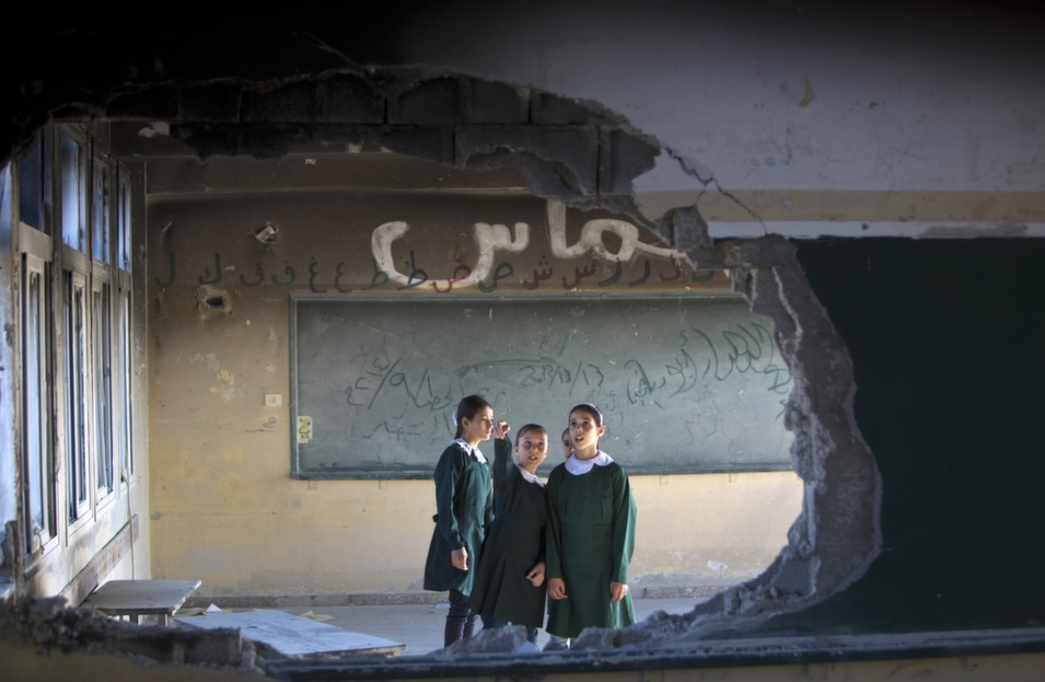 Palestinian students stand in a classroom at a government school in Gaza City's Shejaiya neighborhood, on the first day of the new school year on Sept. 14. Half a million children in Gaza started school about three weeks late following the summer's conflict between Israel and Hamas.       Mahmud Hams/AFP/Getty Images