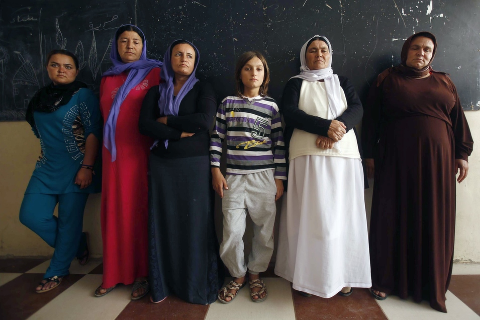 Iraqis displaced by the expansion of the Islamic State (IS) pose for a portrait at a camp in Iraq's Dohuk province, Sept. 13. On Sept. 16, FP's John Hudson reported, U.S. Gen. Martin Dempsey told members of the Senate that he would recommend sending U.S. troops on combat missions against IS militants in Iraq, should the situation demand it.      Mohammed Sawaf/AFP/Getty Images