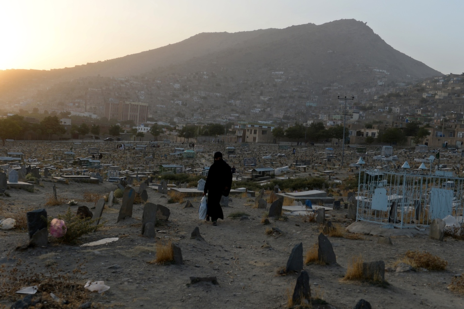 An Afghan woman makes her way home in Kabul, Sept. 18.       Shah Marai/AFP/Getty Images