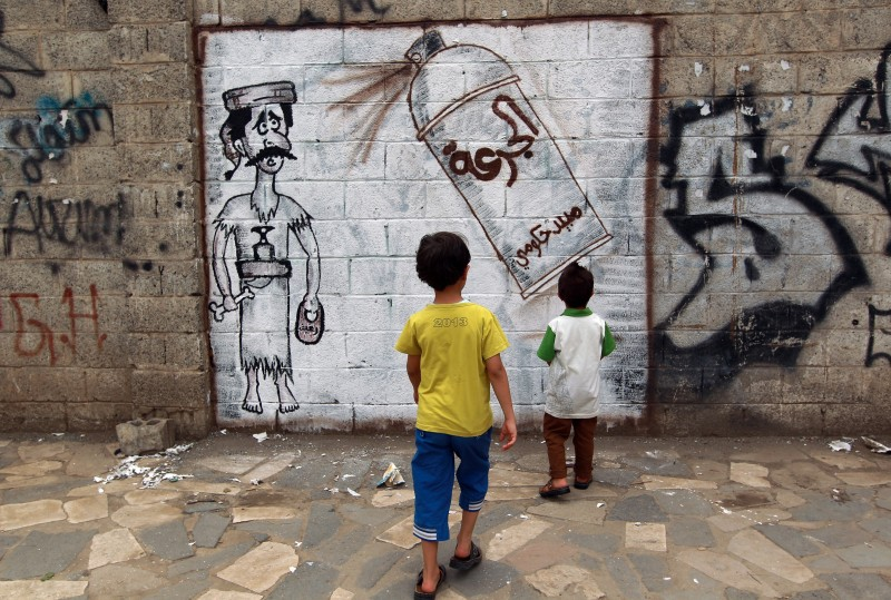 YEMEN-ECONOMY-FEATURE-MURAL-GRAFFITI