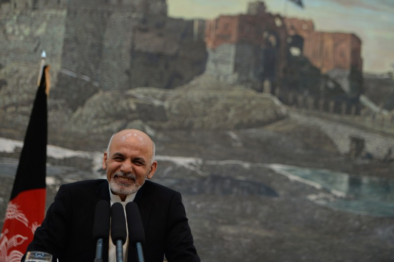 Afghan President Ashraf Ghani smiles as he speaks during a press conference at the Presidential Palace in Kabul on November 1, 2014. China on October 31 hailed an international conference on Afghanistan that it said agreed to launch dozens of programmes to boost development and help the country maintain peace as foreign forces draw down. AFP PHOTO/SHAH Marai        (Photo credit should read SHAH MARAI/AFP/Getty Images)
