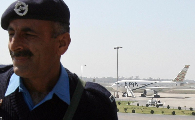 A Pakistani airport security official st