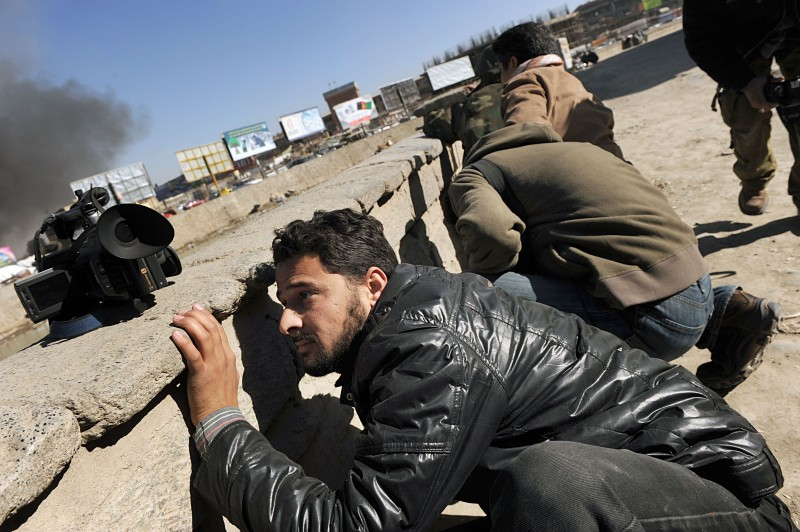 Afghan journalists seek cover at the sce