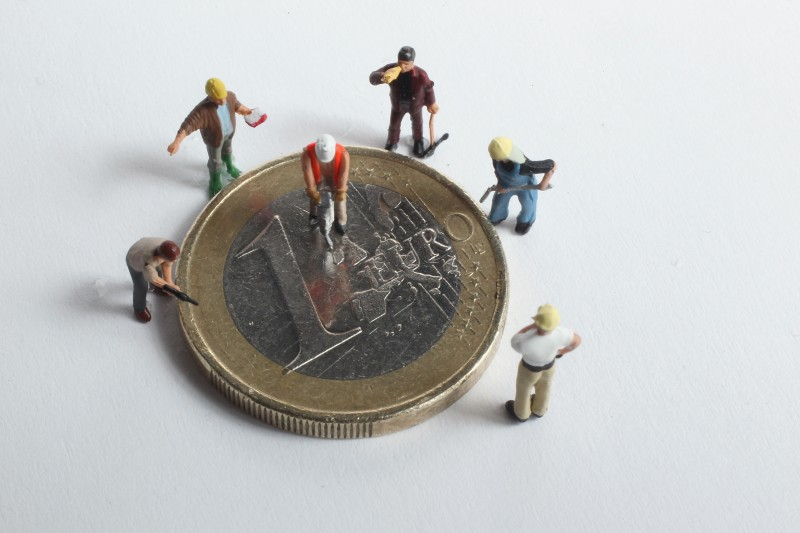 BERLIN, GERMANY - DECEMBER 15: In this photo illustration plastic, toy construction workers stand around a one Euro coin on December 15, 2010 in Berlin, Germany. European leaders are scheduled to meet at a European Union summit in Brussels tomorrow to discuss measures on how to stabilize the Euro that could include the creation of a permanent eurozone bailout system. The Euro has come under severe strain in the last year through the economic problems of some of its members, and a group of nations nicknamed the PIIGS (Portugal, Ireland, Italy, Greece and Spain) have been named by many analysts as the countries posing the biggest threat to the common currency's stability. (Photo Illustration by Sean Gallup/Getty Images)