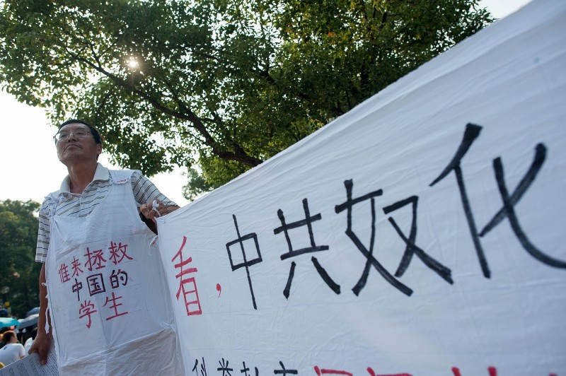 HONG KONG - SEPTEMBER 22:  A man supports the student strike during a rally at Chinese University of Hong Kong on September 22, 2014 in Hong Kong. Thousands of students from more than 20 tertiary institutions start a week-long boycott of classes in protest against Beijing's conservative framework for political reform in Hong Kong.  (Photo by Anthony Kwan/Getty Images)
