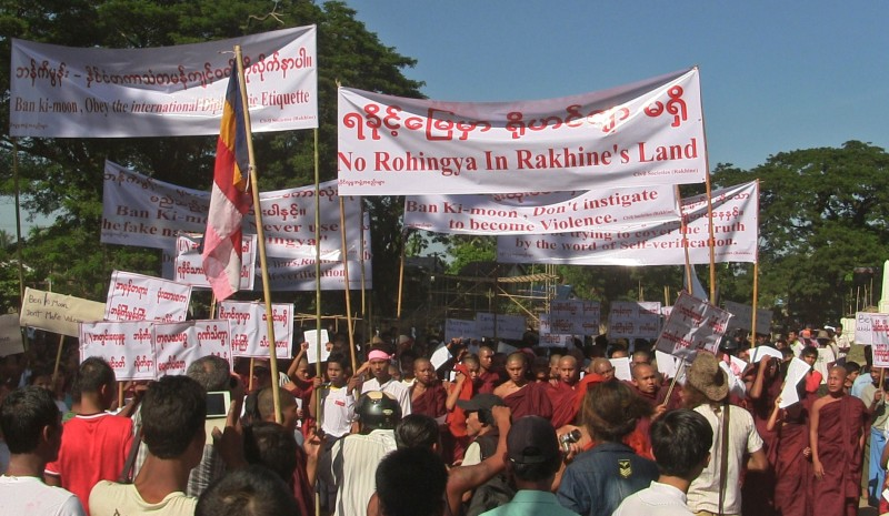 Prosters carry banners during a protest against UN Security General Ban Ki-moon in Sittwe in the western Myanmarese state of Rakhine on November 23, 2014. Myanmar's parliament early November lambasted UN Security General Ban Ki-moon for using the term 'Rohingya', accusing him of interfering in the country's affairs during his visit early November that has kicked off fresh furore over the Muslim minority. AFP PHOTO/STR        (Photo credit should read STR/AFP/Getty Images)