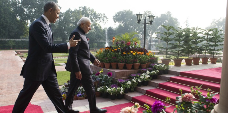 Indian Prime Minister Narendra Modi (R) and US President Barack Obama walk through the gardens between meetings at Hyderabad House in New Delhi on January 25, 2015 (SAUL LOEB/AFP/Getty Images).