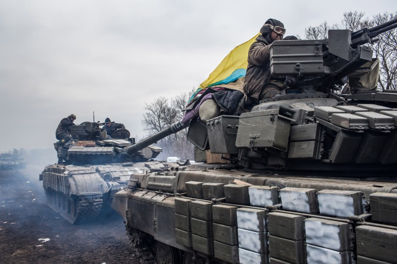 ARTEMIVSK, UKRAINE - FEBRUARY 19: Ukrainian soldiers drive tanks along the road leading out of Debaltseve on February 19, 2015 in Artemivsk, Ukraine. Ukrainian forces have begun withdrawing from the strategic and hard-fought town of Debaltseve after being effectively surrounded by pro-Russian rebels. (Photo by Brendan Hoffman/Getty Images)