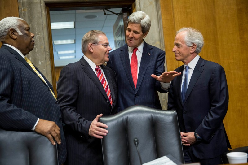 WASHINGTON, DC - APRIL 08:  U.S. Secretary of State John Kerry (C) talks with committee chairman Sen. Robert Mendendez (D-NJ) (L) and ranking member Sen. Bob Corker (R-TN) before Kerry testified during a Senate Foreign Relations Committee hearing concerning the 2015 international affairs budget on Capitol Hill April 8, 2014 in Washington, DC. Kerry discussed a wide range of topics, including the conflict in Syria, relations with Iran, and also discussed the possibility of  additional economic sanctions on Russia. (Photo by Drew Angerer/Getty Images)