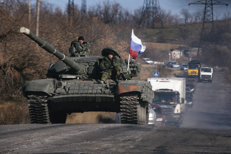 Pro-Russian separatists ride on top of a tank near the town of Krasnyi Luch in Lugansk region, eastern Ukraine, on October 28, 2014. Russia announced it will recognise separatist polls in Ukraine next weekend, fuelling tensions with the country's newly elected pro-Western leaders as they negotiate on forming a coalition government.    AFP PHOTO / DIMITAR DILKOFF        (Photo credit should read DIMITAR DILKOFF/AFP/Getty Images)