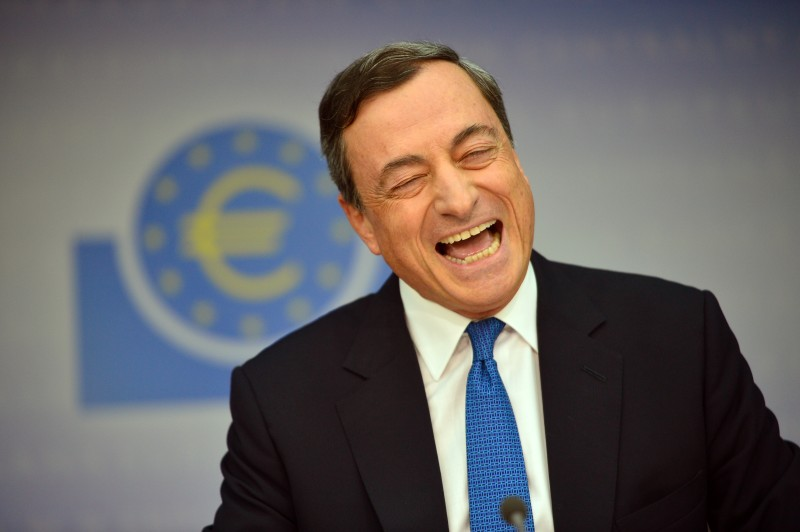 FRANKFURT AM MAIN, GERMANY - NOVEMBER 06:  Mario Draghi, President of the European Central Bank, laughs as he speaks to the media following the monthly ECB board meeting on November 6, 2014 in Frankfurt, Germany. This is the last press conference Draghi will hold as the ECB is in the process of moving into its newly-built headquarters away from the central banking district in Frankfurt.  (Photo by Thomas Lohnes/Getty Images)