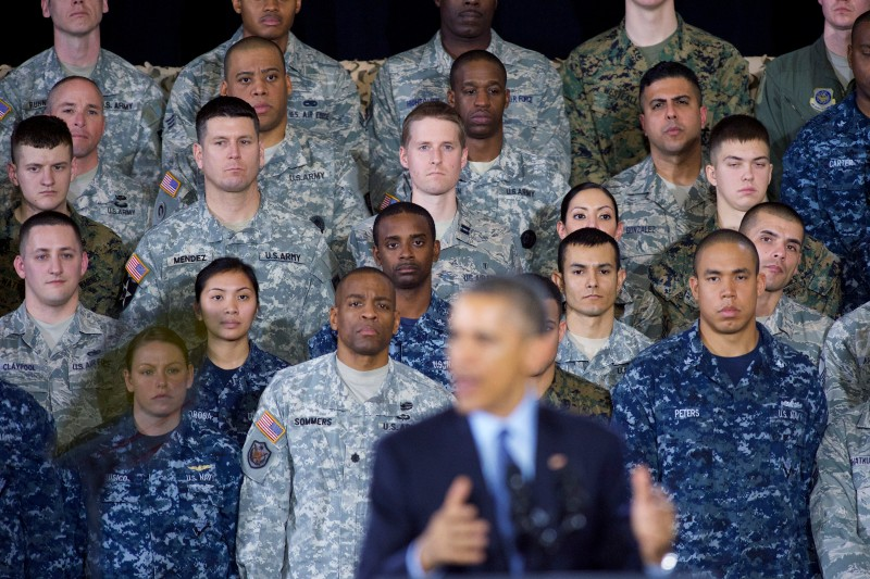 JOINT BASE MCGUIRE-DIX-LAKEHURST, NEW JERSEY - DECEMBER 15:   Members od U.S. audience of armed forces listen to U.S. President Barack Obama speaks December 15, 2014 at Joint Base McGuire-Dix-Lakehurst, New Jersey. Obama will address the troops to thank them for their service and mark the end of the combat mission in Afghanistan. ahead of the upcoming holidays.  (Photo by Mark Makela/Getty Images)