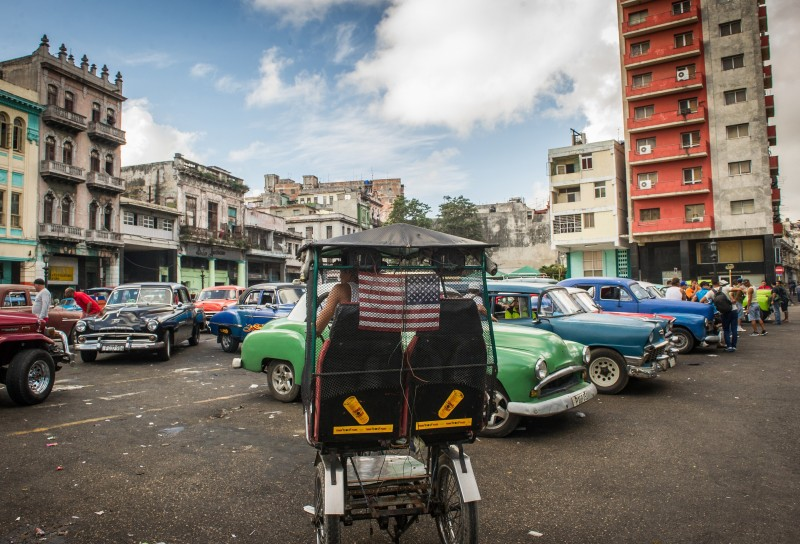 "A pedicab (""bicitaxi"" in Cuba) with a national flag of the United States is seen in Havana, on January 7, 2015. Last month, the United States announced that it would end decades of estrangement and normalize relations with Cuba. Cuba's nascent private sector is bracing for an influx of visitors should the US embargo ease, but many businesses in the communist country appear unprepared for a torrent of tourists.  AFP PHOTO/YAMIL Lage        (Photo credit should read YAMIL LAGE/AFP/Getty Images)"