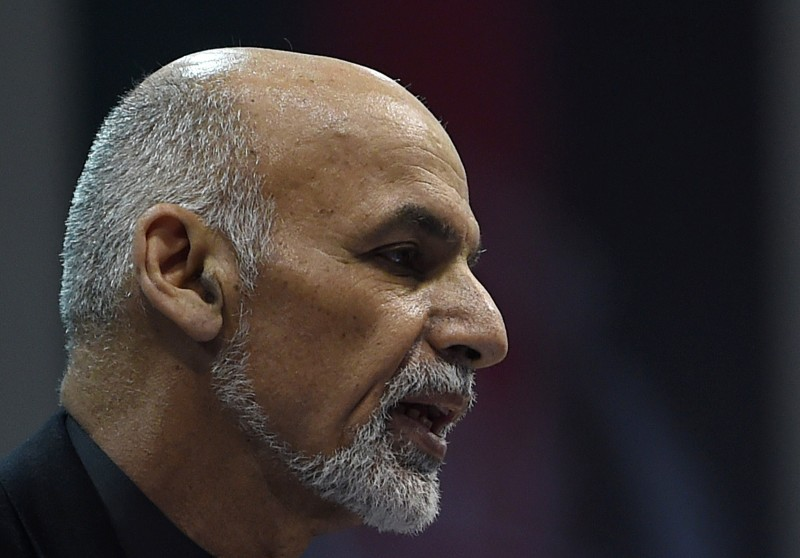 Afghan President Ashraf Ghani speaks during a ceremony to mark the first anniversary of the death of former Afghan vice president Mohammad Qasim Fahim at the loya jirga hall in Kabul on March 9, 2015. Former Afghan vice president Mohammad Qasim Fahim died of natural causes after a turbulent life that reflected the country's recent past. Fahim, a leader of the Tajik ethnic minority, was senior vice-president under President Hamid Karzai.  AFP PHOTO / SHAH Marai        (Photo credit should read SHAH MARAI/AFP/Getty Images)