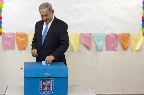 Israeli Prime Minister Benjamin Netanyahu casts his vote during Israel's parliamentary elections in Jerusalem on March 17, 2015. Israelis vote in an election expected to be a close-fought battle between the centre left and Prime Minister Benjamin Netanyahu, who ruled out a Palestinian state in a last-ditch appeal to the right. AFP PHOTO / POOL / SEBASTIAN SCHEINER        (Photo credit should read SEBASTIAN SCHEINER/AFP/Getty Images)