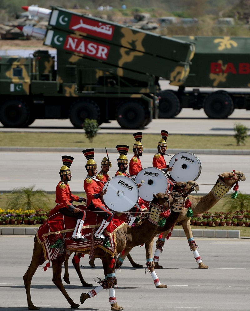 A Pakistani camel-mounted military band performs during the Pakistan Day military parade in Islamabad on March 23, 2015. Pakistan held its first national day military parade for seven years, a display of pageantry aimed at showing the country has the upper hand in the fight against the Taliban. Mobile phone networks in the capital were disabled to thwart potential bomb attacks, some roads were closed to the public and much of the city was under heavy guard for the event. AFP PHOTO/ Aamir QURESHI        (Photo credit should read AAMIR QURESHI/AFP/Getty Images)