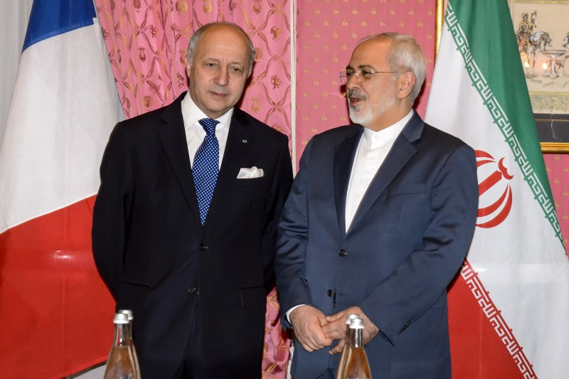 "French Foreign Minister Laurent Fabius (L) meets with Iranian counterpart Mohammad Javad Zarif during nuclear talks in Lausanne on March 28, 2015. Fabius arrived at nuclear talks with Iran in Switzerland saying he wants to achieve a ""robust"" deal. AFP PHOTO / FABRICE COFFRINI        (Photo credit should read FABRICE COFFRINI/AFP/Getty Images)"