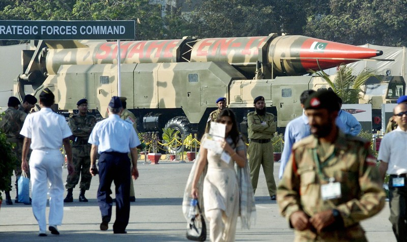 """Karachi, PAKISTAN:  Visitors walk in front of the Pakistani nuclear-capable ballistic missile Shaheen on display during a four-day an International defence exhibition ? Ideas 2006 ? in Karachi, 21 November 2006.  Around 230 companies from more than 50 countries, including the United States, France, Germany, China and Turkey, are participating in the annual show. Organisers said this year's theme was """"Arms for Peace"""". Pakistan's military-run defence industry exports arms and ammunition worth 100 million dollars annually to countries in the Middle East, Asia and Africa.                 AFP PHOTO/Asif HASSAN  (Photo credit should read ASIF HASSAN/AFP/Getty Images)"""