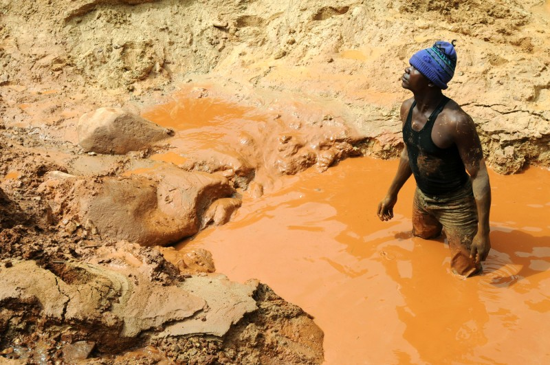 A man stands in a pool of water in a gold mine on February 23, 2009 in Chudja, near Bunia, north eastern Congo. The conflict in Congo has often been linked to a struggle for control over its resources. Congo is rich in mineral resources such as gold, diamonds, tin, and cobalt. The Democratic Republic of Congo government and the main former rebel group reached preliminary agreement on a wider peace deal for the east of the country on February 22, sources on both sides said. AFP PHOTO / LIONEL HEALING (Photo credit should read LIONEL HEALING/AFP/Getty Images)