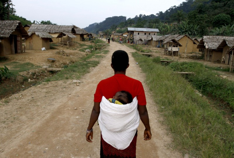 A Congolese woman walks on September 3,