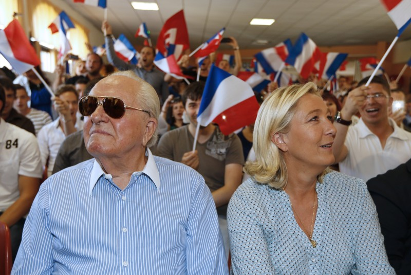 French far-right leader Marine Le Pen (R) and her father France's former far-right leader Jean-Marie Le Pen attend a youth summer congress of the Front National (FN) far-right party , on september 7, 2014, in Frejus, southern France.   AFP PHOTO / VALERY HACHE        (Photo credit should read VALERY HACHE/AFP/Getty Images)