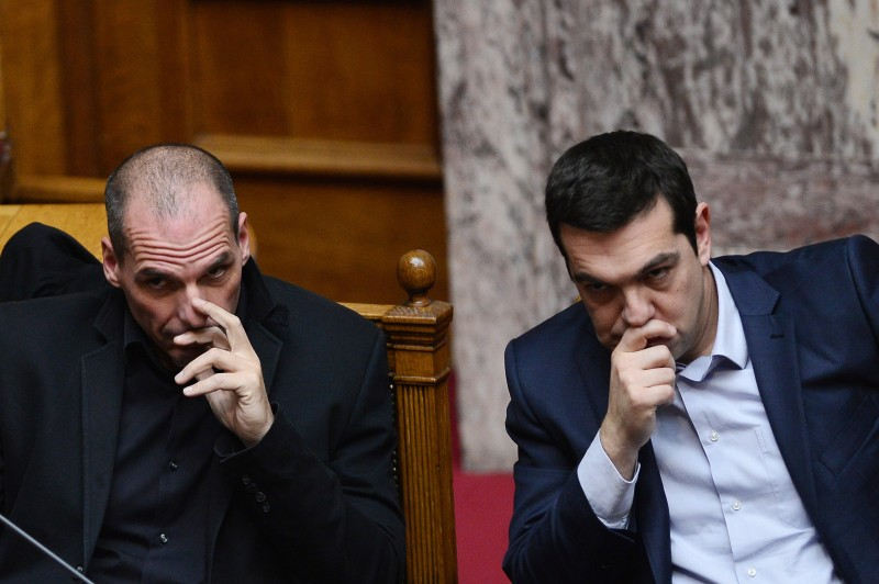 Greek Prime Minister Alexis Tsipras (R) sits along side Finance Minister Yianis Varoufakis during the vote for the president, at the Greek parliament in Athens, on February 18, 2015.  Greece's parliament elected pro-European conservative Prokopis Pavlopoulos as the country's new president, a move calculated to bolster the hard-left government in its critical EU bailout talks. AFP PHOTO / LOUISA GOULIAMAKI        (Photo credit should read LOUISA GOULIAMAKI/AFP/Getty Images)