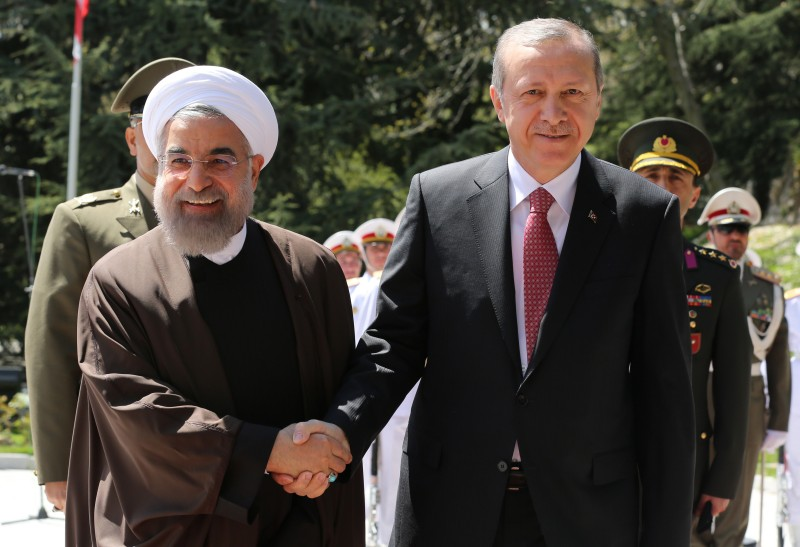 Iran's President Hassan Rouhani shakes hands with Turkish President Recep Tayyip Erdogan (R) during an official welcoming ceremony following the latter's arrival at the Saadabad Palace in Tehran on April 7, 2015, for an official one-day visit as the two countries criticized each other in recent weeks on their respective policies in the region. AFP PHOTO/ATTA KENARE        (Photo credit should read ATTA KENARE/AFP/Getty Images)
