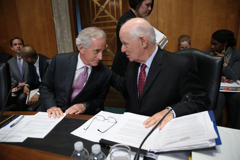 WASHINGTON, DC - APRIL 14:  Senate Foreign Relations Committee Chairman Sen. Bob Corker (L) (R-TN) confers with ranking member Sen. Ben Cardin (R) (D-MD) during a committee markup meeting on the proposed nuclear agreement with Iran April 14, 2015 in Washington, DC. A bipartisan compromise reached by Corker and Cardin would create a review period that is shorter than originally proposed for a final nuclear deal with Iran and creates compromise language on the removal of sanctions contingent on Iran ceasing support for terrorism.  (Photo by Win McNamee/Getty Images)