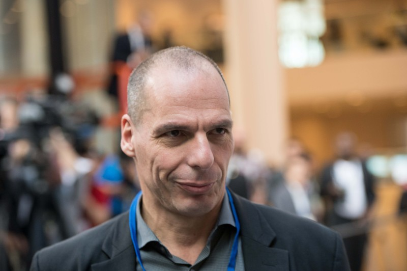 Greek Finance Minister Yanis Varoufakis waits for the International Monetary and Financial Committee (IMFC) family photo at the IMF/WB Spring Meetings in Washington, DC, on April 18, 2015.    AFP PHOTO/NICHOLAS KAMM        (Photo credit should read NICHOLAS KAMM/AFP/Getty Images)