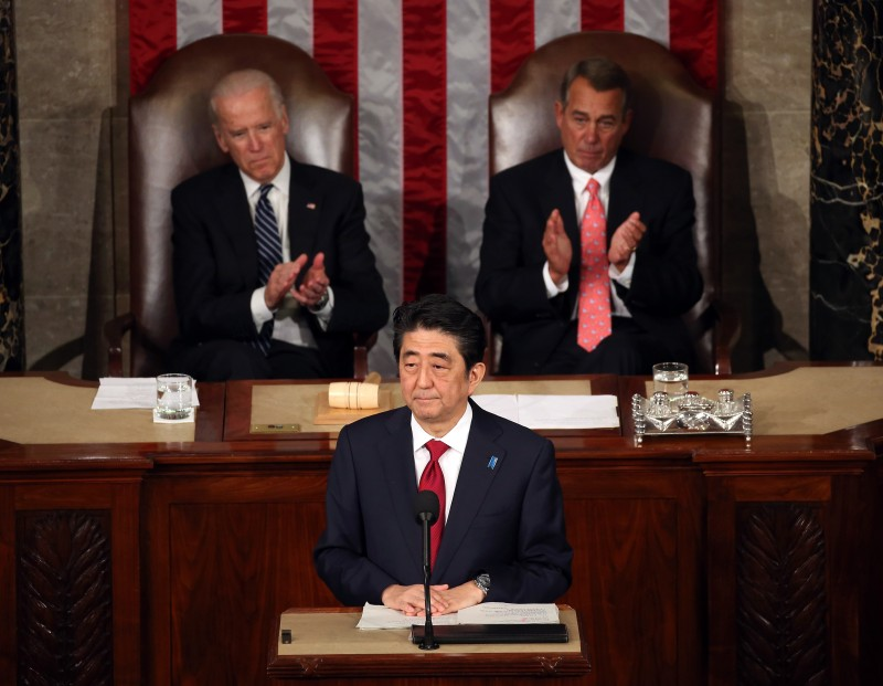 WASHINGTON, DC - APRIL 29:  Japanese Prime Minister Shinzo (C) speaks to a joint meeting of the US Congress while flanked by Vice President Joseph Biden (L) and House Speaker John Boehner (R-OH) (R) in the House chamber of the US Capitol April 29, 2015 in Washington, DC.The Prime Minister and his wife are on an official visit to Washington.  (Photo by Mark Wilson/Getty Images)
